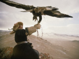 Kazakh Hunter Strains to Support a Golden Eagle