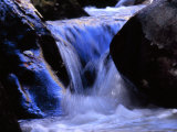 Water Cascading Over Stones in a Gentle Small Waterfall
