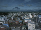 Mt Fuji Looms on the Distant Horizon Beyond a Japanese Town