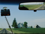 View of a Rural Road Through a Windshield with a Radar Detector