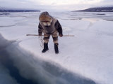 An Inuit Hunter Waits For Seals on an Ice Floe