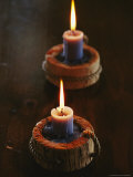 Two Candles in Rustic Candlesticks