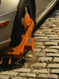 """Car with a """"Booted"""" Tire on a Cobblestone Street in Georgetown"""