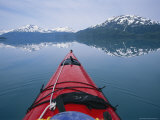 Kayak Plies Calm Waters Where Mountains Seem to Meet the Water