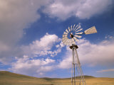 Old Windmill on Ranch Under Blue Sky with Clouds