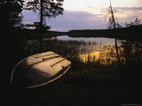 An Upturned Rowboat on the Shore of Iskwasum Lake at Sunset