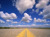 Cumulus Clouds in Blue Summer Sky Over Paved Road