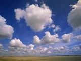 Cumulus Clouds in Blue Sky Over Prairie