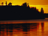 The Setting Sun Casts an Orange Glow Over Manitoba's White Lake
