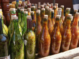 Close View of a Colorful Group of Bottles Containing Foodstuffs