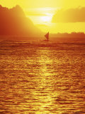 Outrigger Sailing in Calm Water at Sunset Off of Hanalai