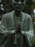 Statue of a Zen Buddhist Monk Holding Prayer Beads