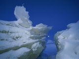 Moon is Framed by Wild Ice Formations