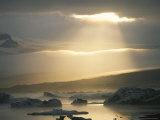 Beams of Sunlight Bathe Glacial Lake Jokullsarlon
