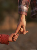 Touching Close-up of a Mother and Daughter Holding Hands