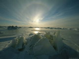 Sun Sets over a Field of Ice in Canada