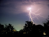 Bolt of Lightning Brightens a Night Sky