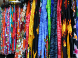 Bright Fabric Racks in an Abstract View at an Outdoor Flea Market