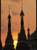 Silhouetted Spires of a Buddhist Temple at Twilight