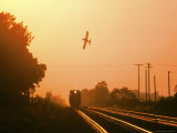 Aerial Crop Duster and Train at Sunrise