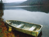 Old Rowboat on the Shore of Douthat Lake in Rain