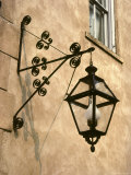 Iron Street Lamp Hangs From a Historic Building