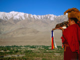 Monk Sounding Puja Horn across Valley  Thiksey Gompa