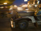 Jeepney Speeds Through Night in Malate