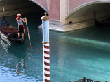 Woman Rowing Gondola in Replica of Venice Canal  Las Vegas