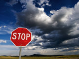 Stop Sign on Plains with Clouds Above