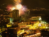Fireworks Exploding over City Buildings During Summer Celebrations