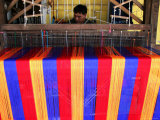 Man Weaving Cloth