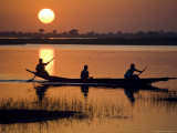 Young Boys Paddling on the Niger River in Segoukoro