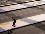Teenage Boy Skateboarding on Road  Docklands