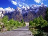 Road of the Karakoram Highway Leading Towards Cloud-Swathed Mountains