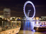 Blurred London Eye Reflected in the Thames at Night with Floating Restaurants in the Foreground