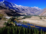 Gilgit River Cutting Through the Cultivated Valley with Mountains in the Background  Phander