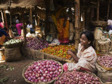 Woman Selling Onions in the Vegetable Market