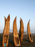 Caballitos De Totora Stacked Vertically in Order to Dry Between Fishing Trips