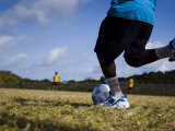 Torres Strait Islander Boy Taking a Goal Kick During a Soccer Game