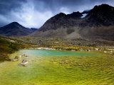 Colorful Lake Surrounded by Mountains in Stortinddalen  Lyngsalpene