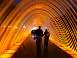 People Walking Through One of the 13 Illuminated Fountains at El Parque De La Reserva