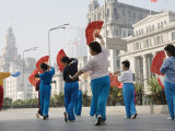 Women Practising Tai Chi with Fans on the Bund
