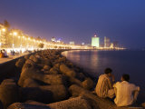 People Relax at the End of Day Along Marine Drive