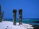 Two Tall Wooden Ki&#39;I Stand Guard Near Hale O Kaewe Heiau at Pu`Uhonua O Honaunau