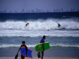 Surfers with Surfers Paradise in Distance