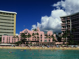 Exterior of the Royal Hawaiian Hotel with Waikiki Beach in Foreground