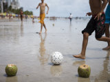 Boys Playing Beach Football with Coconut Goal Posts