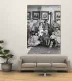 Four Generations of Farmers in Ozark Family Posing in Front of Portraits of Their Fifth Generation