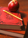 Red Apple on Books with Pencil